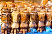 stock photo of tiki  - tiki figures at the market, cook islands