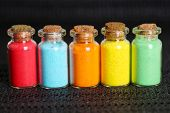 stock photo of pigment  - Bottles with colorful dry pigments on dark background - JPG