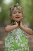 pic of little girls photo-models  - Little girl modeling for the camera in the outdoors