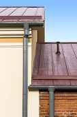 pic of gutter  - Part of a house with metal roof wall and rain gutter - JPG
