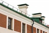 image of downspouts  - Rain gutter and downspout newly installed on historic building - JPG