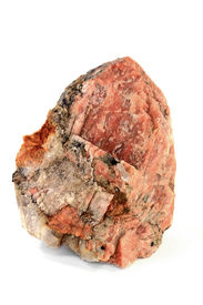 picture of feldspar  - Piece of Potassium Orthoclase Feldspar with enclosures of Granite rock from which is built more than half of curst of the Earth the striations are clear visible over the Orthoclase  - JPG