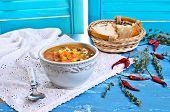stock photo of vegetable soup  - Soup of red lentils and vegetables in a ceramic plate - JPG