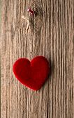 stock photo of soulmate  - Love heart hanging on wooden texture background - JPG