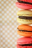 image of french pastry  - Traditional french colorful macaroons on retro background - JPG