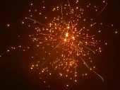 stock photo of firework display  - a starry fireworks display in dark back - JPG