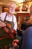 pic of leaving  - Customer Leaving Violin For Repair In Shop - JPG