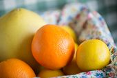 foto of pomelo  - Citrus fruits include pomelo lime and orange are mix in a closeup view - JPG