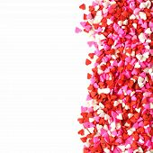 stock photo of sprinkling  - Valentines Day candy heart border of red - JPG