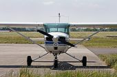 image of cessna  - Cessna light aircraft parked at an airfield - JPG