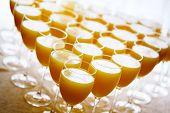 foto of catering service  - Fresh orange juice in high glasses - JPG