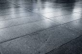 pic of paving stone  - Old wet stone paved avenue street road low angle after rain - JPG