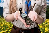 foto of boy scout  - Girl scout holding the compass traveling in the mountains - JPG