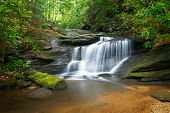 pic of backwoods  - Motion Blur Waterfalls Peaceful Nature Landscape in Blue Ridge Mountains with lush green trees rocks and flowing water - JPG