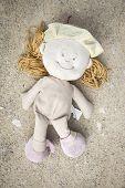 image of rag-doll  - an abandoned rag doll on the floor - JPG