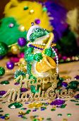 picture of gator  - Gator playing a saxaphone celebrating Mardi Gras