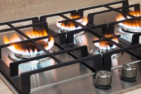 image of grils  - Gas burning in the burner of gas oven - JPG