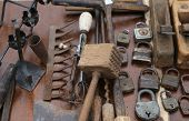picture of flea  - wooden hammer and rusty padlocks and planers in the workshop of flea market