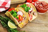 pic of tacos  - Mexican food Tacos on wooden table - JPG