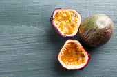 picture of passion fruit  - Passion fruits on wooden background - JPG