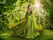 foto of fairy  - Fantasy Fairy Tale Forest Fairytale Nature Goddess Nymph Woman in Mysterious Green Dress - JPG