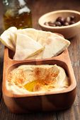 picture of pita  - Hummus with sliced pita bread on a rustic table - JPG
