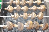 pic of brazier  - Brown juicy mushrooms cooked on the brazier - JPG