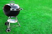 picture of charcoal  - BBQ Charcoal Grill Appliance On The Lawn Background With Copy Space - JPG