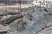 stock photo of earth structure  - Installation of engineering structures ground loop at the initial stage of construction - JPG