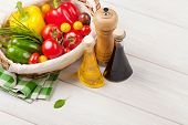 stock photo of condiment  - Fresh vegetables and condiments on wooden table - JPG