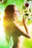 foto of tropical plants  - Beautiful brunette woman in bikini among tropical plants - JPG