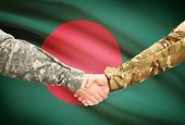 picture of bangladesh  - Soldiers shaking hands with flag on background  - JPG