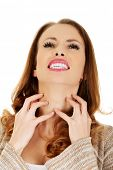 stock photo of throat  - Woman suffering from throat pain - JPG