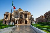 foto of palace  - Palace of fine arts facade and Mexican flag on downtown of Mexico capital city - JPG