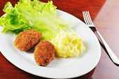 picture of pork cutlet  - roasted cutlets of pork with potato and lettuce - JPG