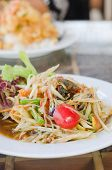 picture of green papaya salad  - Thai spicy papaya salad serve with vegetables