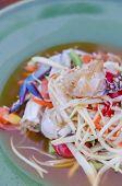 stock photo of papaya  - Famous Thai style food spicy papaya salad - JPG