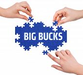 picture of  bucks  - Hands with puzzle making BIG BUCKS word isolated on white - JPG