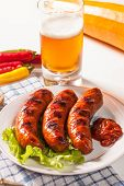 stock photo of grilled sausage  - Grilled sausage on a plate - JPG