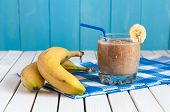 picture of light weight  - Healthy homemade banana juice in glass and fresh bananas on light wooden background - JPG