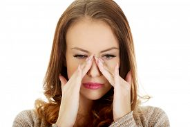 picture of sinuses  - Woman suffering from sinus pressure pain - JPG