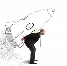 stock photo of spaceships  - Businessman dreams to achieve success with spaceship - JPG