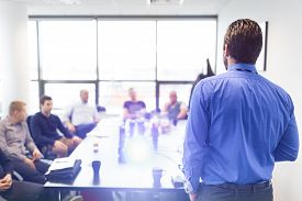 stock photo of employee  - Business man making a presentation at office - JPG