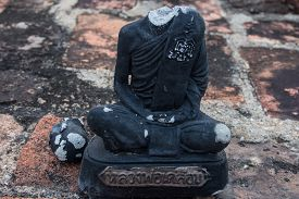 stock photo of beheaded  - Statue of buddha without head at Sukhothai historical park in Thailand - JPG
