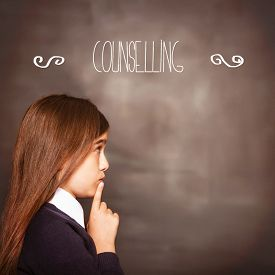 picture of counseling  - The word counselling against cute pupil looking a chalkboard - JPG