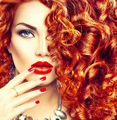 Beauty young woman with curly red hair, perfect make up and manicure. Permed hair. Glamour lady, Bea poster