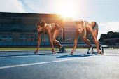 Determined Female Athletes Ready To Start A Race poster