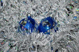 stock photo of x-max  - Clear glass Christmas balls decorated with blue sparkles - JPG