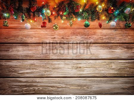 poster of Christmas fir tree with decoration on wooden board. Bright Christmas and New Year background with empty space for text. Christmas decorations on wooden background