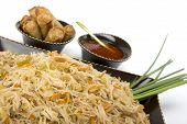 stock photo of lumpia  - Pancit on a ceramic dish with egg rolls and sweet and sour sauce